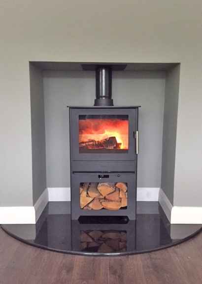 Heta Inspire 45 with log-store. Custom made 20mm curved hearth.