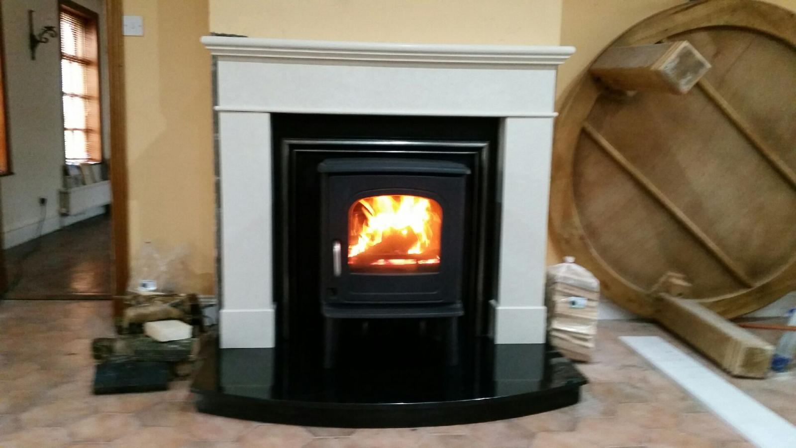 Dru 55 8kw with ivory cream Kos surround and curved granite hearth