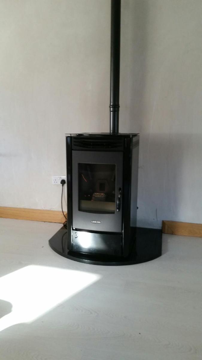 Pellet Lincar Perla Black metallic on granite hearth. Works wonderfully with Niamh's heat recovery system!