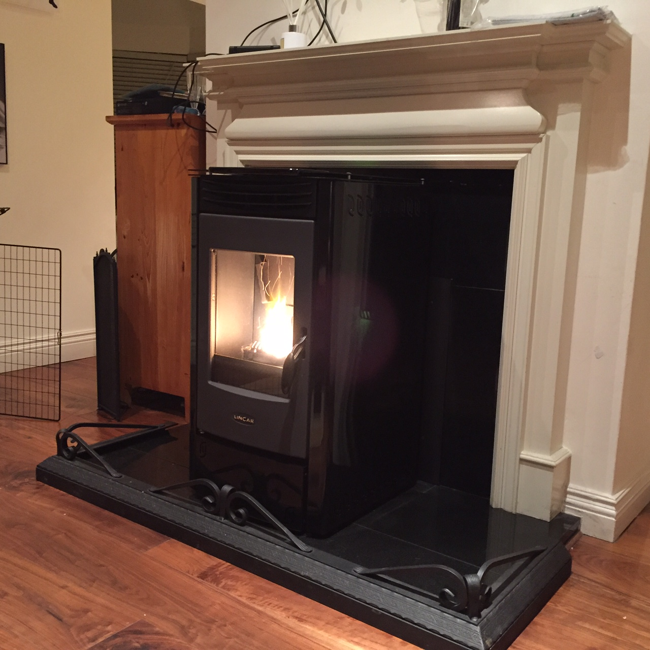 Lincar Perla pellet stove. Fitted in front of original marble fireplace with hearth extension to the back of the stove.