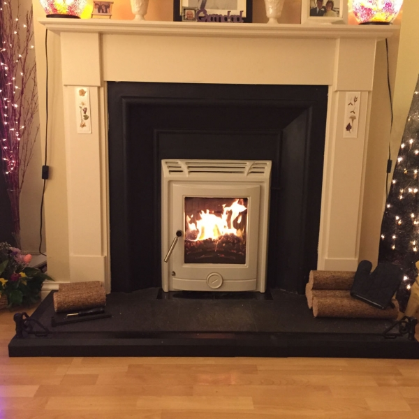 Tuscon 5kw Inset stove in Ivory cream. Matches beautifully with the classic surround.
