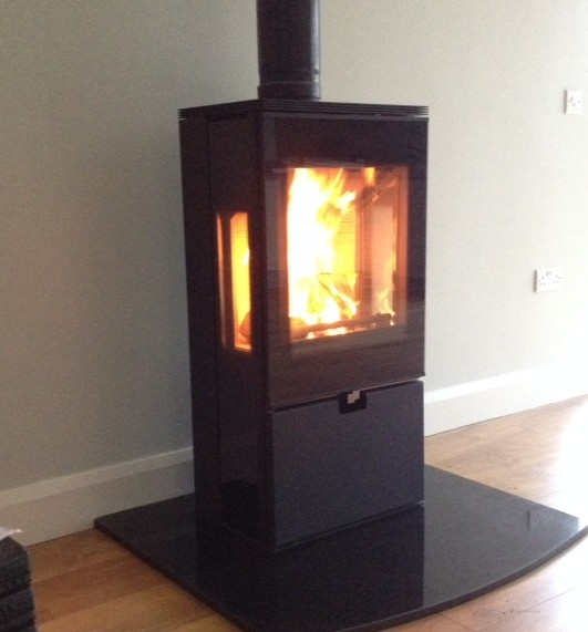 Thorma Weisbaden on granite hearth with curved front