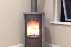 Heta Scanline 500 in Complete Sandstone and honed granite hearth