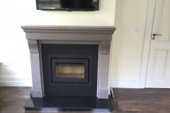 Heta Classic 2 insert in a Cabra Sienna stove fireplace.