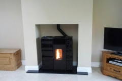 The black tiled Olga pellet stove. Available with vent.