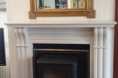 Dru 55 stove for continuous or intermittent use. Fitted with a curved hearth and Dublin Corbel fireplace.