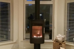 Contemporary Heta 7D 6kw stove on smoked glass hearth