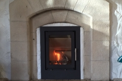 Heta Scanline 550 cassette, fitted into existing sandstone fireplace