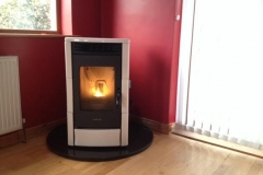 Lincar Milly with white tiles on teardrop granite hearth