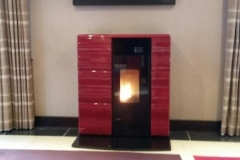 Pellet Lincar Olga, maroon, ceramic; on black granite hearth