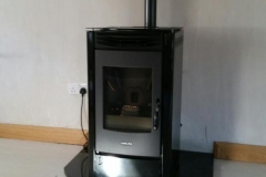 Pellet Lincar Perla Black metallic on granite hearth. Works wonderfully with Niamh's heat recovery system!