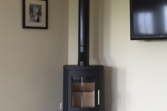 Heta Scan-Line 800, on a honed granite hearth and twin-walled through the house.