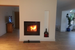 Dik Guerts Tunnel stove with custom made granite hearth and surround